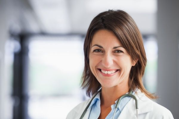 Smiling female nurse practitioner from shoulders up