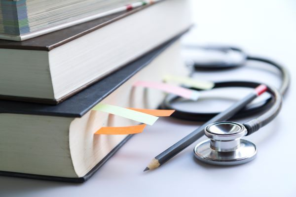 Close-up of medical textbooks and stethoscope